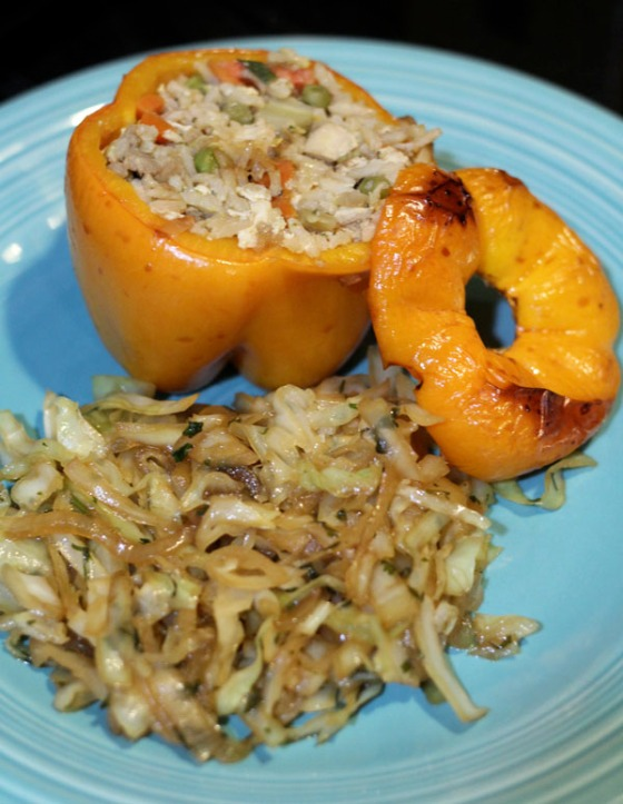 Fried Rice Stuffed Peppers served with Braised Cabbage and Onions.