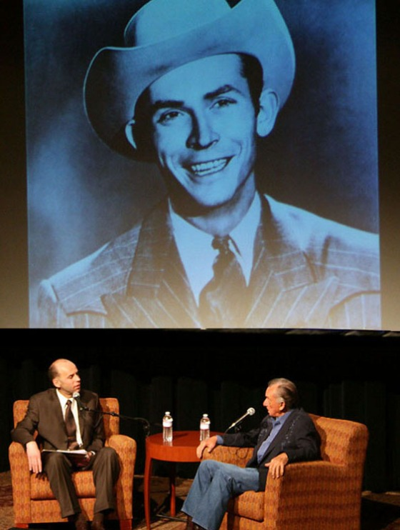 Eddie Stubbs interviewing Ray Price at the CMHF with Hank looking on.