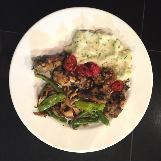 Mediterranean Chicken Wings with Roasted Cherry Tomatoes served with Herbed Mashed Potatoes and Sautéed Green Beans with Mushrooms.